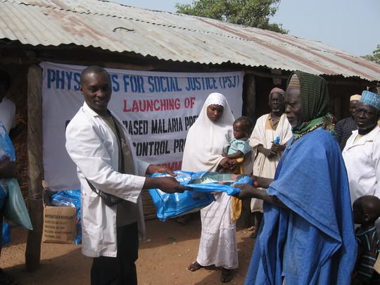 Village head of Faje receiving the ITNs from PSJ team on behalf