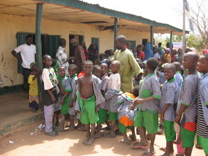 School children lined up to receive to recieve antimalaria chemo