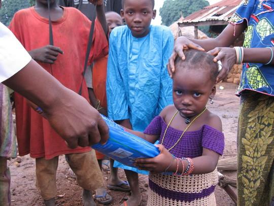 An OVC recieving ITN from PSJ malaria in sabonriji