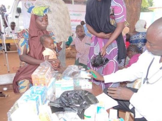 an infant receiving malaria treatment
