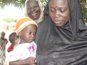 A mother & her child waiting for malaria treatment