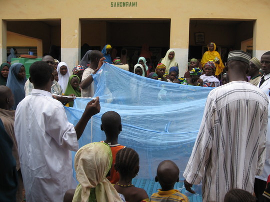 PSJ project team demostrating how to use nets to women in Sahon