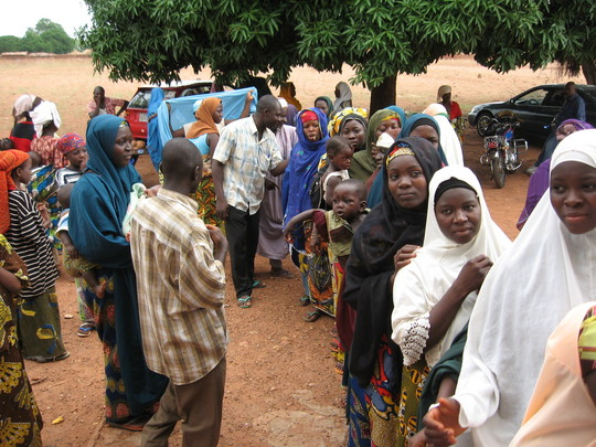 Women line up to receive treated nets at sabon-rijia village