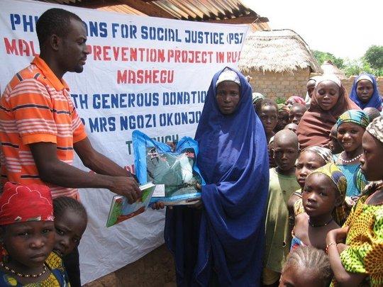 A pregnant woman receiving ITN at T-magai village