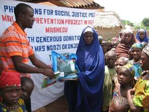 A pregnant woman receiving ITN at T-magai village