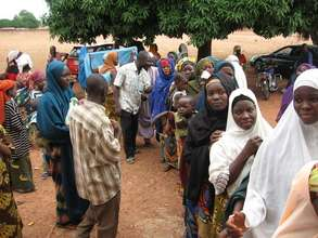 Women line up to receive Insecticide Treated Nets