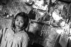An IDP Kachin girl in her camp home
