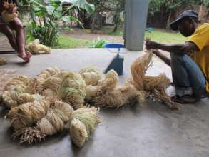 SEPALI team processes raw raffia bundles