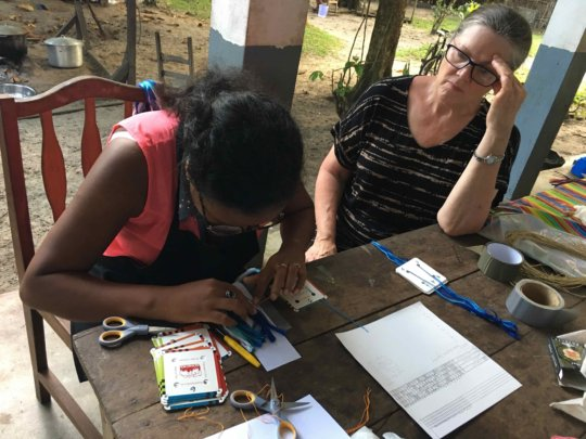 Lalaina learns how to set-up cards for weaving
