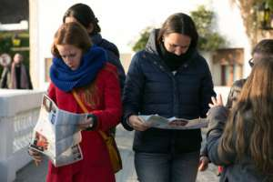 Tourists read campaign information