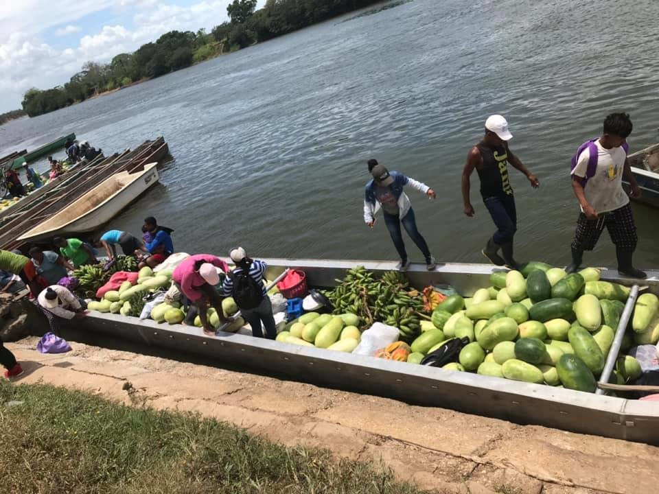 Women load the boat with produce