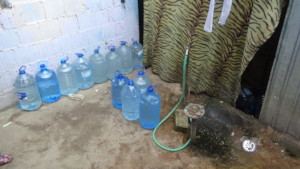Bottles filled with water for later use