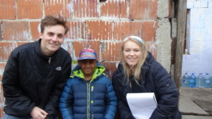 Volunteers Jack and Mabel with Isuf
