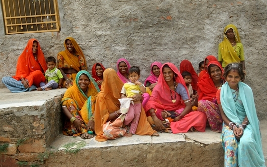 Women attending Village meeting.