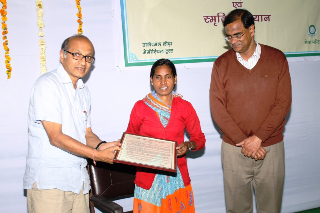 Ambavi receiving award for her outstanding efforts