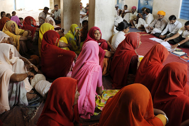 Women participating in Village meetings.