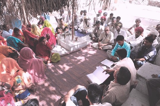 Meeting conducted in a Village.