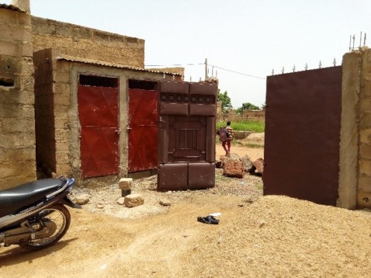 Construction of toilets, fixture of doors and gate
