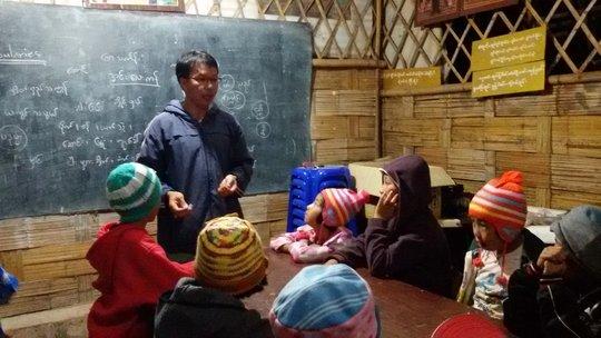 Sai Oo teaching the children of his community