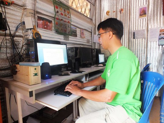 Using the computer in the refugee camp