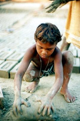 Child making bricks. (Copyright U. Roberto Romano)