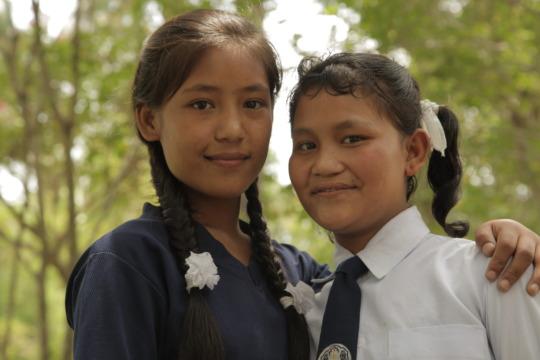 At Sanju's new school, she and Maya have reunited.