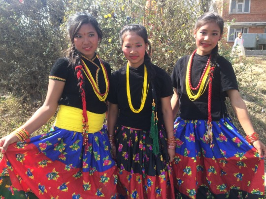 Maya and friends in the traditional dress of Nepal