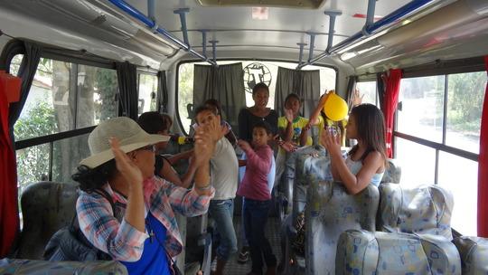 Inside the bus a farewell song.