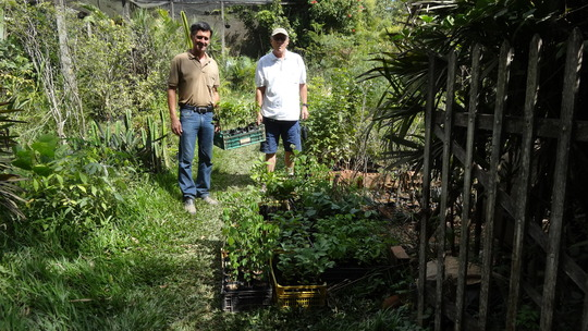 Renato, the greenhouse owner and me.
