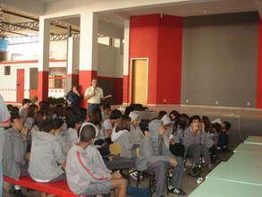 Students listen attentively.