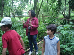 Teacher and students at the tree nursery.