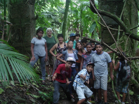 Group visiting ruins ancient coffee farm.