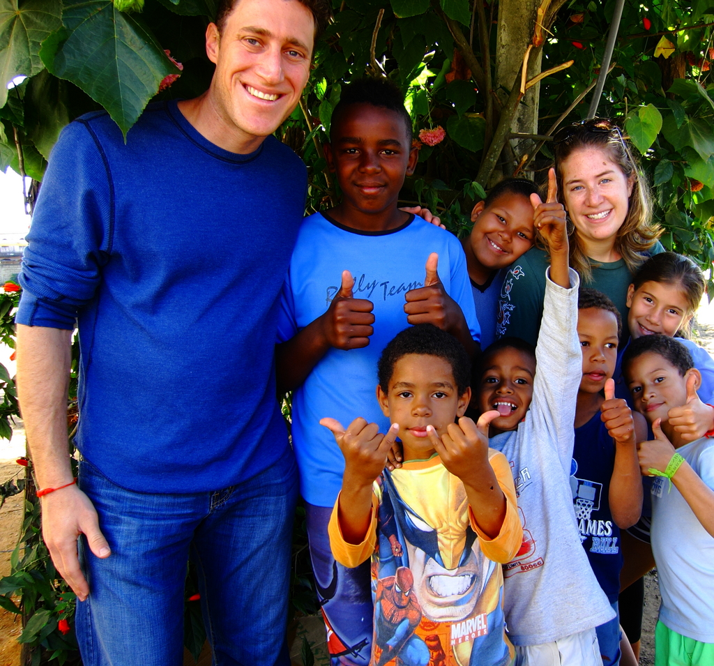Melissa and I and children outside of Valença