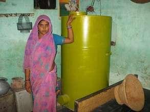 Sunita Devi with her storage bin