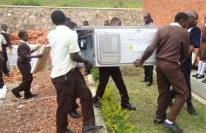 NVSS students carrying in lab equipment
