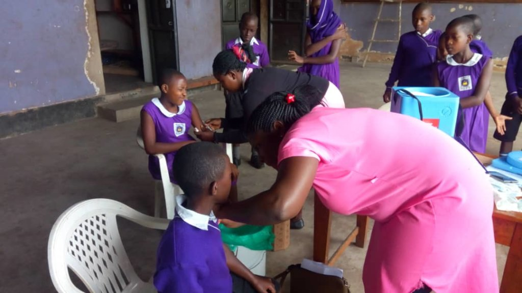 Nyaka students receiving Measles immunization