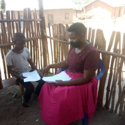 Student Receiving Materials From Teacher Lydia
