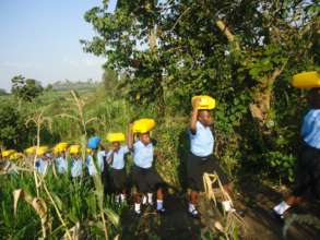 NVSS students carrying water in jerry cans