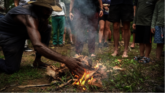 Traditional owner conducting smoking ceremony