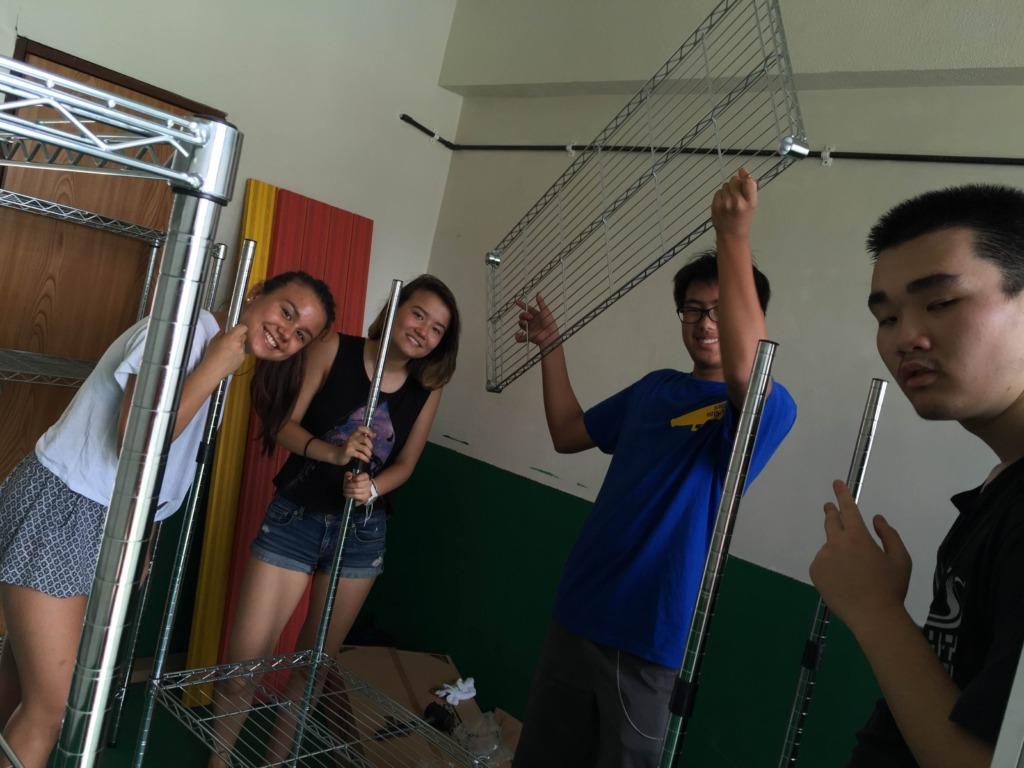 Teens assembling the shelves