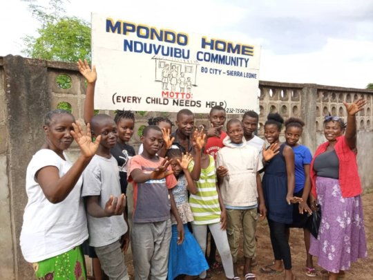 Mpondo Home staff & 11 orphans now with families