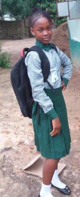 Sierra Leonean girl in her new school uniform.