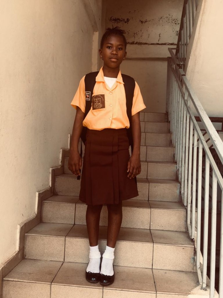 Student with new uniform and supplies