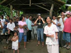 A Filipino family benefiting from a ram pump