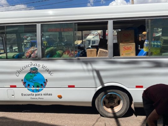 loading up the bus-food for 97 families
