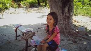 Little girl's shining smile in break time