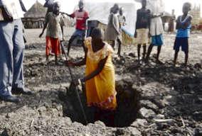 Process of digging a latrine pit