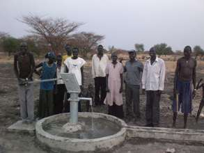 Community members and their new borehole