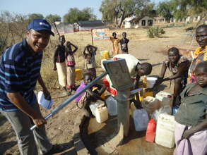 Beneficiaries using their new clean water source