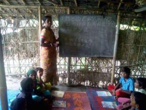 Rahela teaching at the Dhekipara Learning Centre
